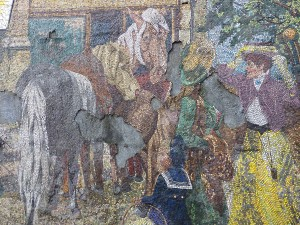 Horsefair by Kenneth Budd, 1968, Holloway Circus roundabout, Birmingham This beautiful mosaic is made from tiny pieces of coloured Venetian glass and depicts the city's historic horse fair. A closer look reveals the growing grey patches where the mural has come away from the wall. Whilst being completed, which took about a month, some of the spectators became friendly regulars. One regular was a man who ran a horse and carriage wedding service and was able to identify the different type of horses and said that 'his old dad who remembered the old Horse Fair would vouch for the authenticity of the work'. © Historic England